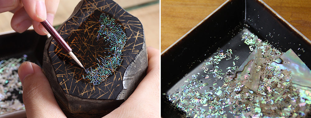貝殻を極薄に切り出し、数字などに成形して漆の上に1つ1つ手作業で貼り付けていく。